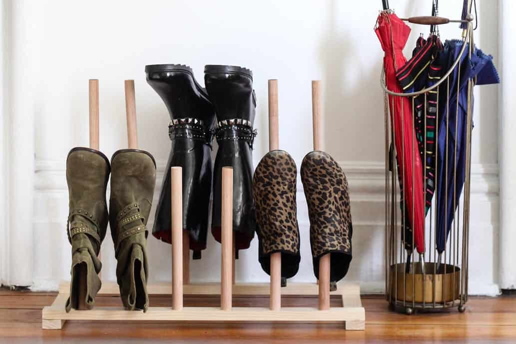 DIY wooden shoe storage rack to help organize your shoes.
