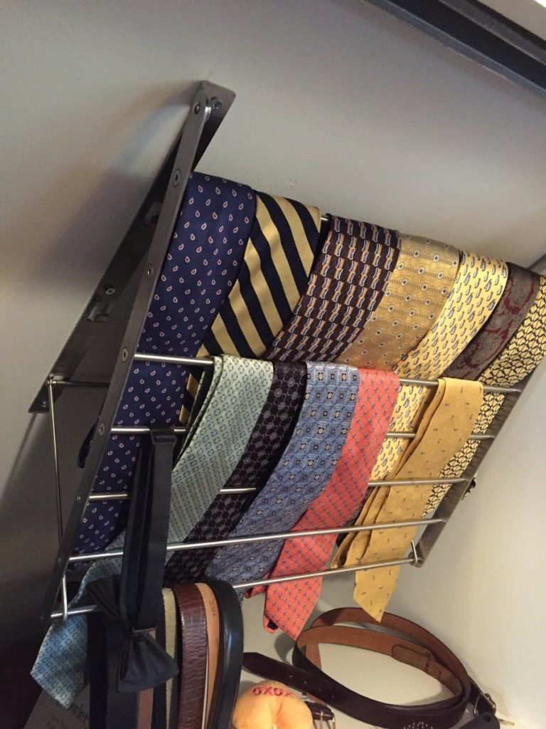 Tie storage in the small part of the closet.