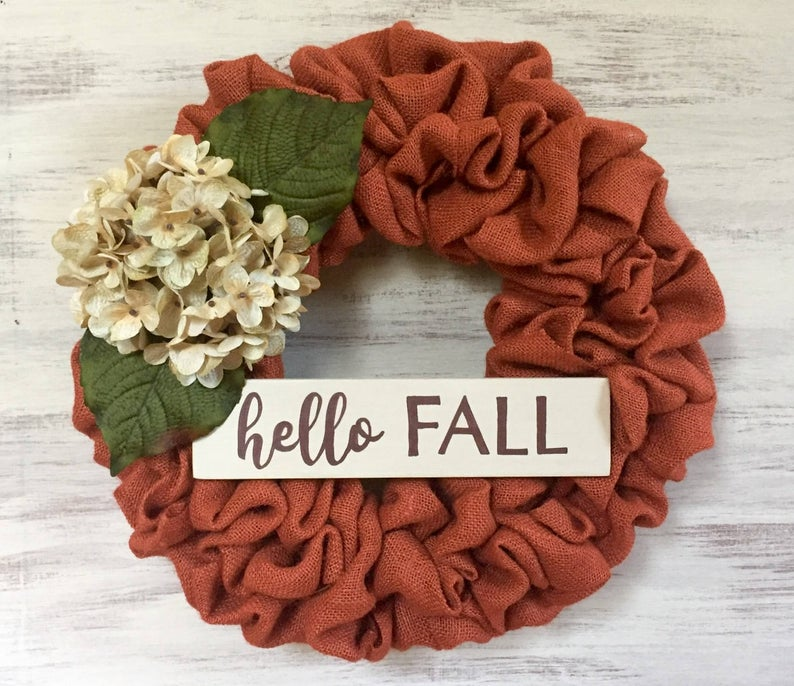 Orange burlap wreath with dried hydrangea.