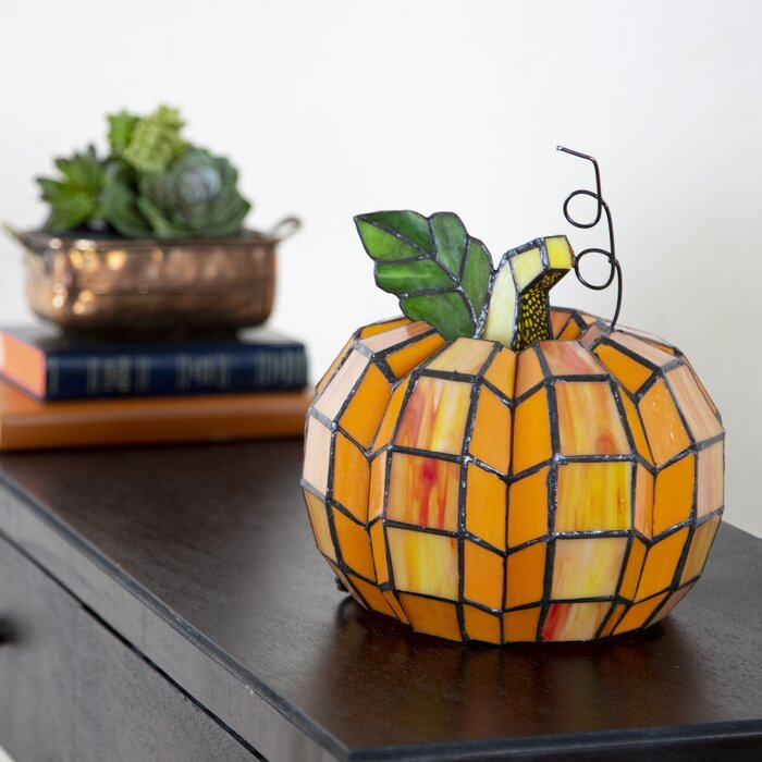 All of the Fall decor in one tiny glass pumpkin.
